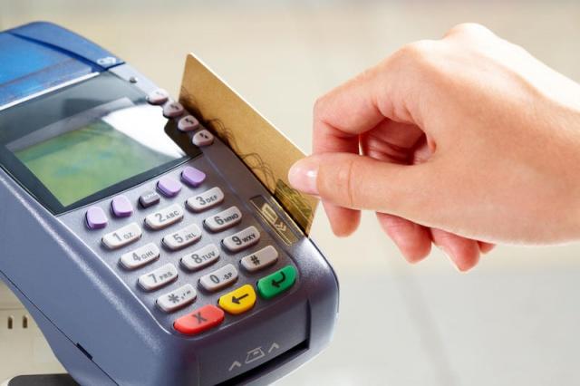 Терминал оплаты по банковским картами